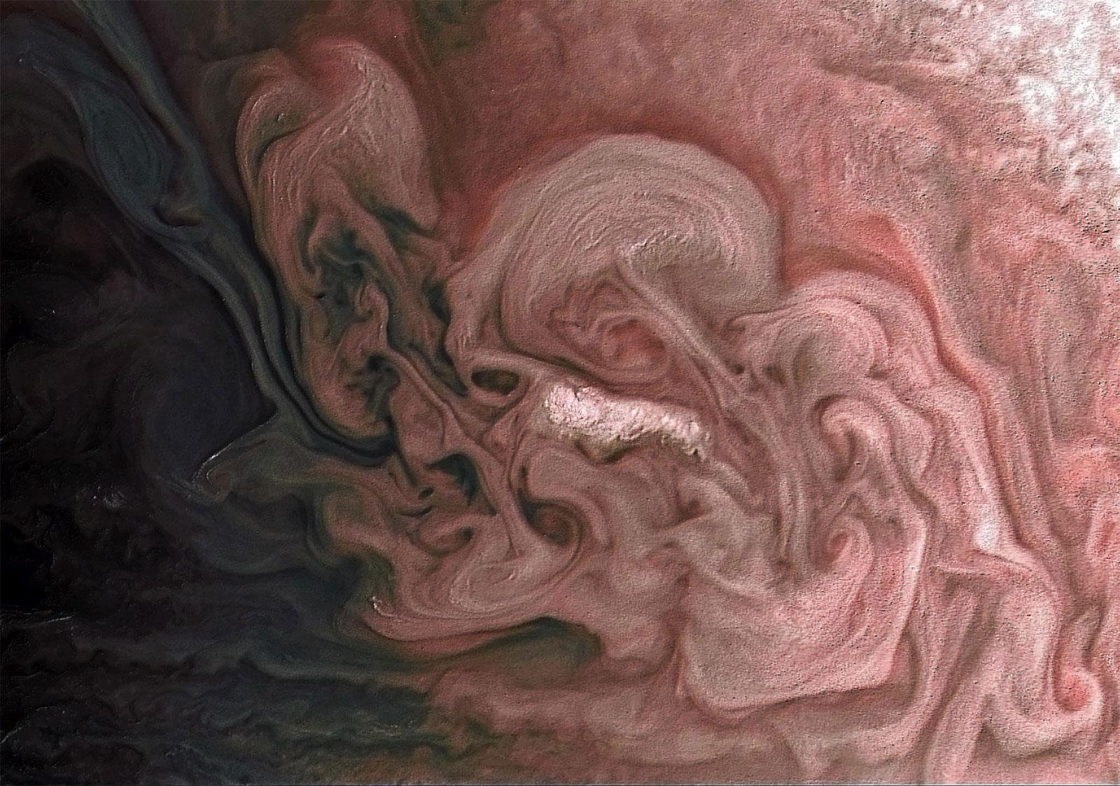Juno was able to capture a Jupiter storm and emboss texture to allow scientists to understand the surface details.